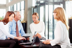 stock-photo-57171396-teamwork-with-laptop-at-office