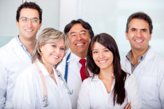 stock-photo-19315275-patient-with-a-group-of-doctors