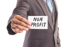 stock-photo-77130245-businessman-s-hand-and-non-profit-message
